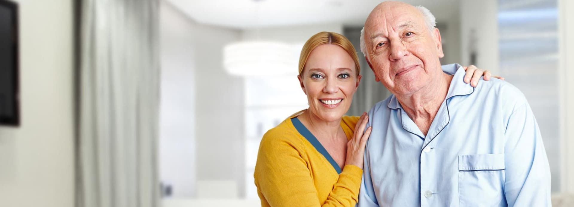 caregiver and senior man standing