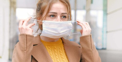 girl putting mask on